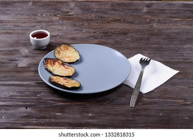 fried eggplant with sauce on a plate