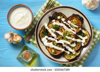 Fried eggplants with garlic and yogurt sauce.
