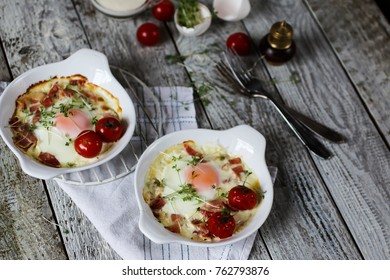 fried eggs with bacon in a plate on a table, selective focus