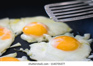 Fried eggs being cooked
