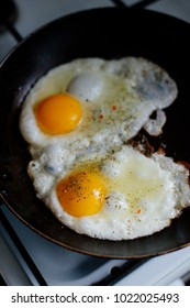 Fried eggs for breakfast early in the morning. Scrambled eggs with spices.