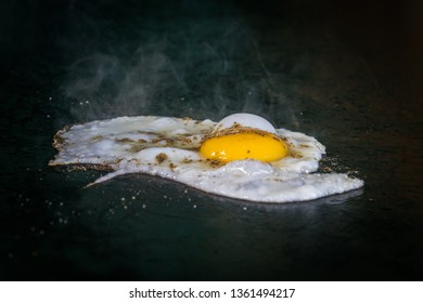 Fried eggs fried eggs in a pan. Hot appetizing dish that is eaten unmarried men and poor students. one fried egg