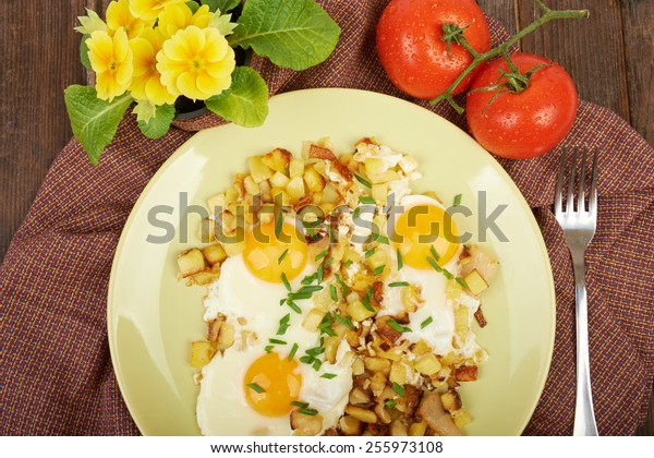 Fried eggs in a plate on the table
