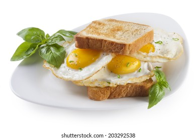 Fried Eggs sandwich on a plate isolated
