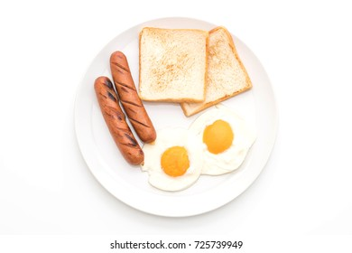 fried eggs with sausage and bread isolated on white background