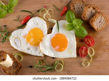 Fried eggs in the shape of a heart