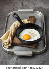 Fried eggs with smoked paprika in a frying pan