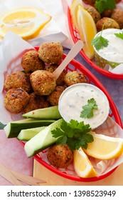 Fried falafel balls with garlic dip and cucumber
