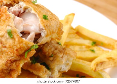 Fried fish and chips on the white plate
