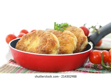 fried fish cutlets in the corn flour on a white background
