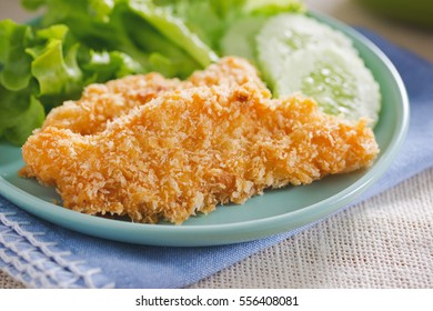 fried fish fillet serve with vegetable,thai food