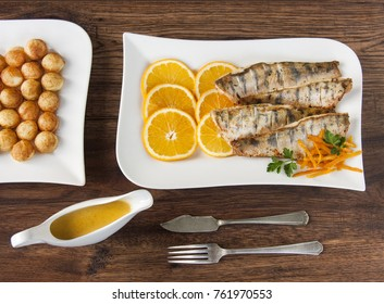 Fried fish fillet of zander with orange sause. Fried zander fillets. Zander in the oranges. Fish dish. Food and drink