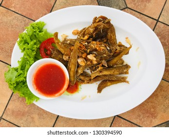 fried fish, focus food on the disc in restaurant atmosphere, food business, food safety and food for life concept
