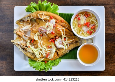 Fried fish with fresh herbs and sweet spicy sauce