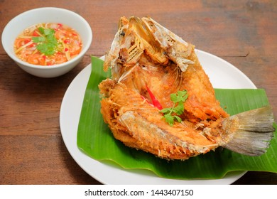 Fried fish with​ fish sauce​ and mango salad