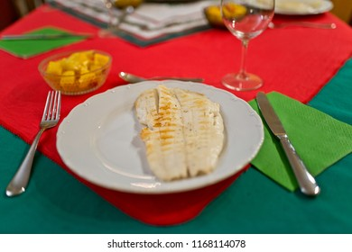 Fried fish on the plate at the Christmas eve.
