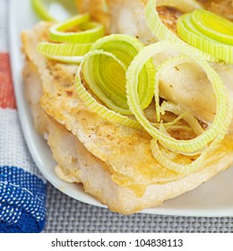 Fried fish with onions