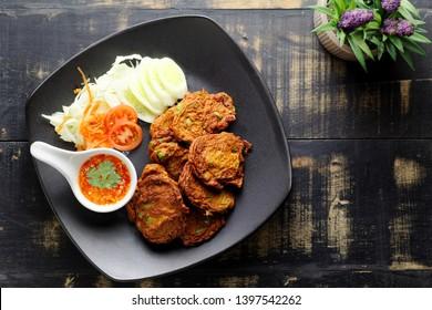 fried fish patty or Thai Fish cake (Tod mun pla) on dark background