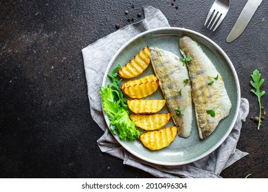 fried fish and potatoes pike perch fish fresh seafood food organic products meal snack copy space food background rustic. top view keto or paleo diet vegetarian food pescetarian diet