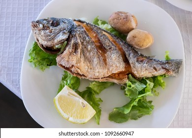 Fried fish with potatoes in a restaurant in the village of Candelaria on the coast of Tenerife, Canary Islands