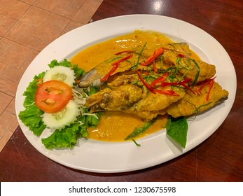Fried Fish with Red Curry Paste Chu Chee Pla on white plate , Thai food, Asian food.