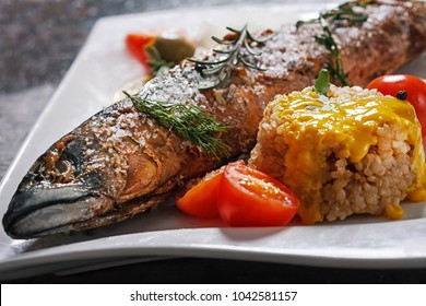 fried fish with rice and vegetables