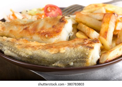 fried fish - saffron cod with potatoes and vegetables