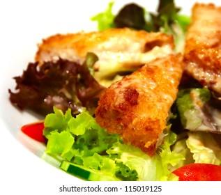 fried fish salad on white background