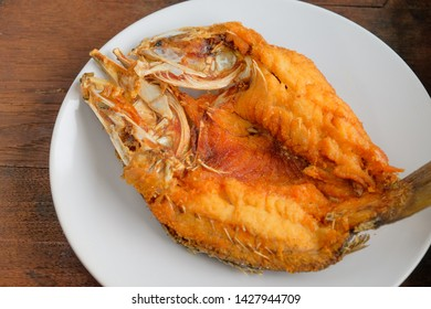 Fried fish with fish sauce on dish