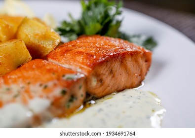 Fried fish served with potato and sauce