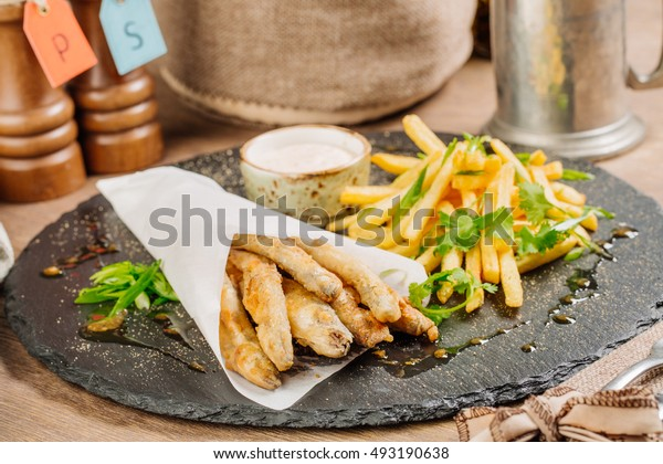 Fried fish - smelt with the potatoes and sauce