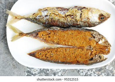 fried fish with thai hot and spicy mixed herb