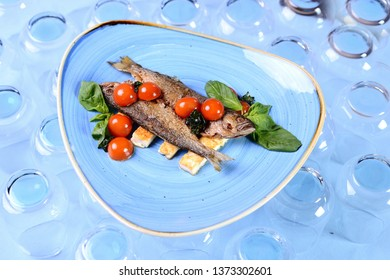 fried fish with vegetables and basil