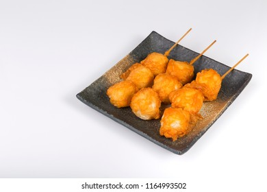 Fried fishball with skewer  in square dish on white background. This food is street food in Thailand
