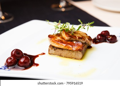Fried foie gras with cherry sauce and figs