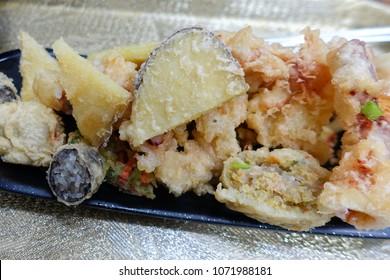 Fried food. Korean snack. Food to eat together when eating tteokbokki. Deep-fried Glass Noodles in Seaweed (gim mari twigim), Sweet Potatoes (goguma twigim), Squid and vegetables (yachae twigim).