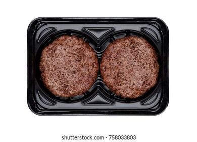 Fried fresh beef burgers in plastic tray  on white background