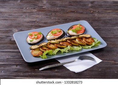 fried and fresh vegetables on a plate