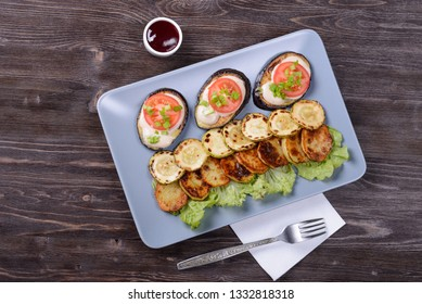 fried and fresh vegetables on a plate with cranberry sauce