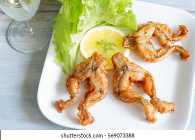 Fried frog legs on plate food concept