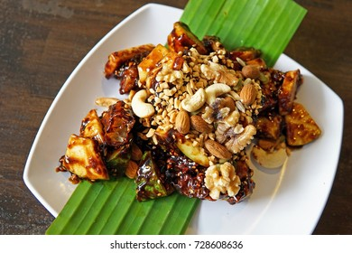 Fried fruits and nuts with black sweet sauce called Rojak is delicious famous asian food