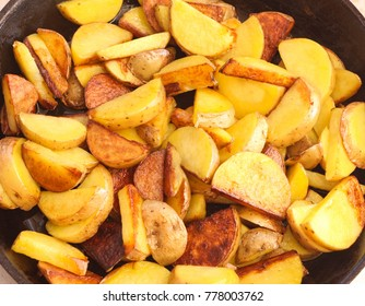 fried golden potatoes in a frying pan