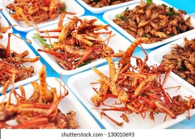 Fried grasshoppers in Thailand market