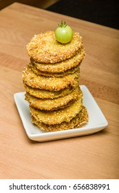 Fried green tomato sandwich ready to serve on white plate