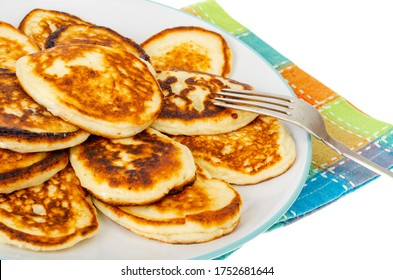 Fried homemade pancakes on plate, colored napkin. Studio Photo
