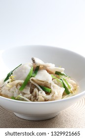 fried hor fun noodle kway teow with seafood in egg gravy