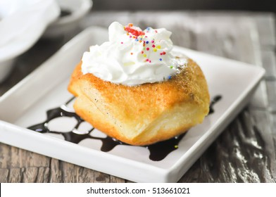 Fried ice cream and whipped cream topping dish