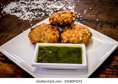 Fried Indian Festival Snack of Sabudana Vada Plated with Mint Chutney and Tapioca Pearls