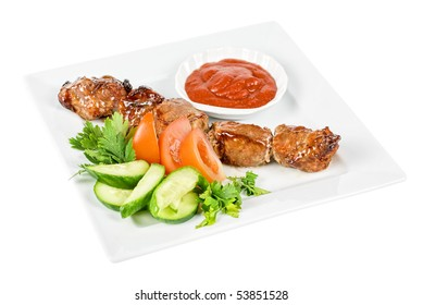 Fried kebab meat with vegetables and sauce