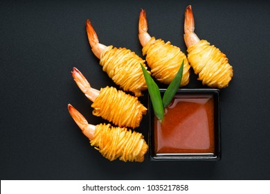 Fried king prawn appetising  snack.  Japanese dumplings  with prawn, top view on the black background